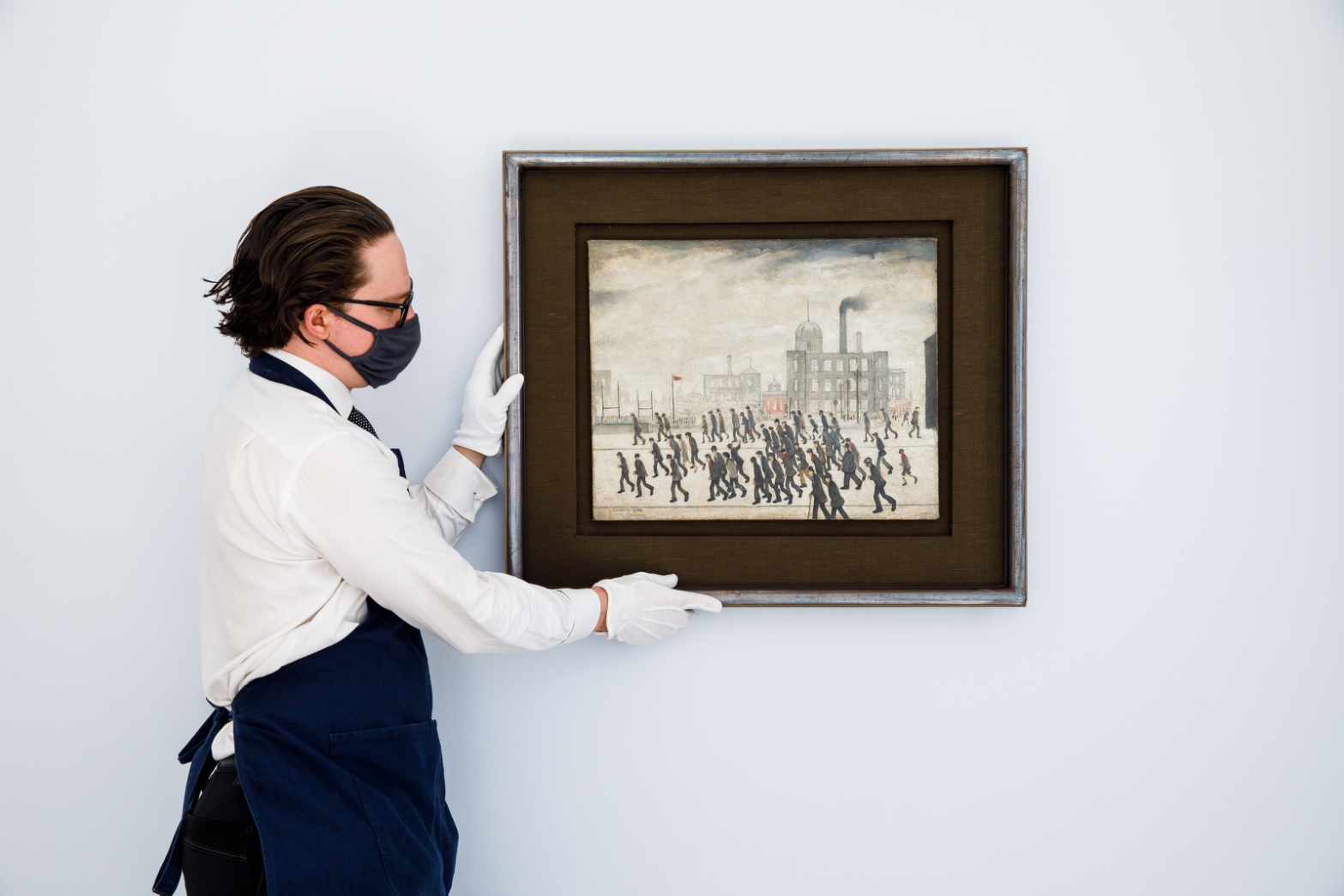 Lot 13- L_S_ Lowry, Going to the Match, 1928, oil on canvas 17 by 21in_ in situ 2.jpg