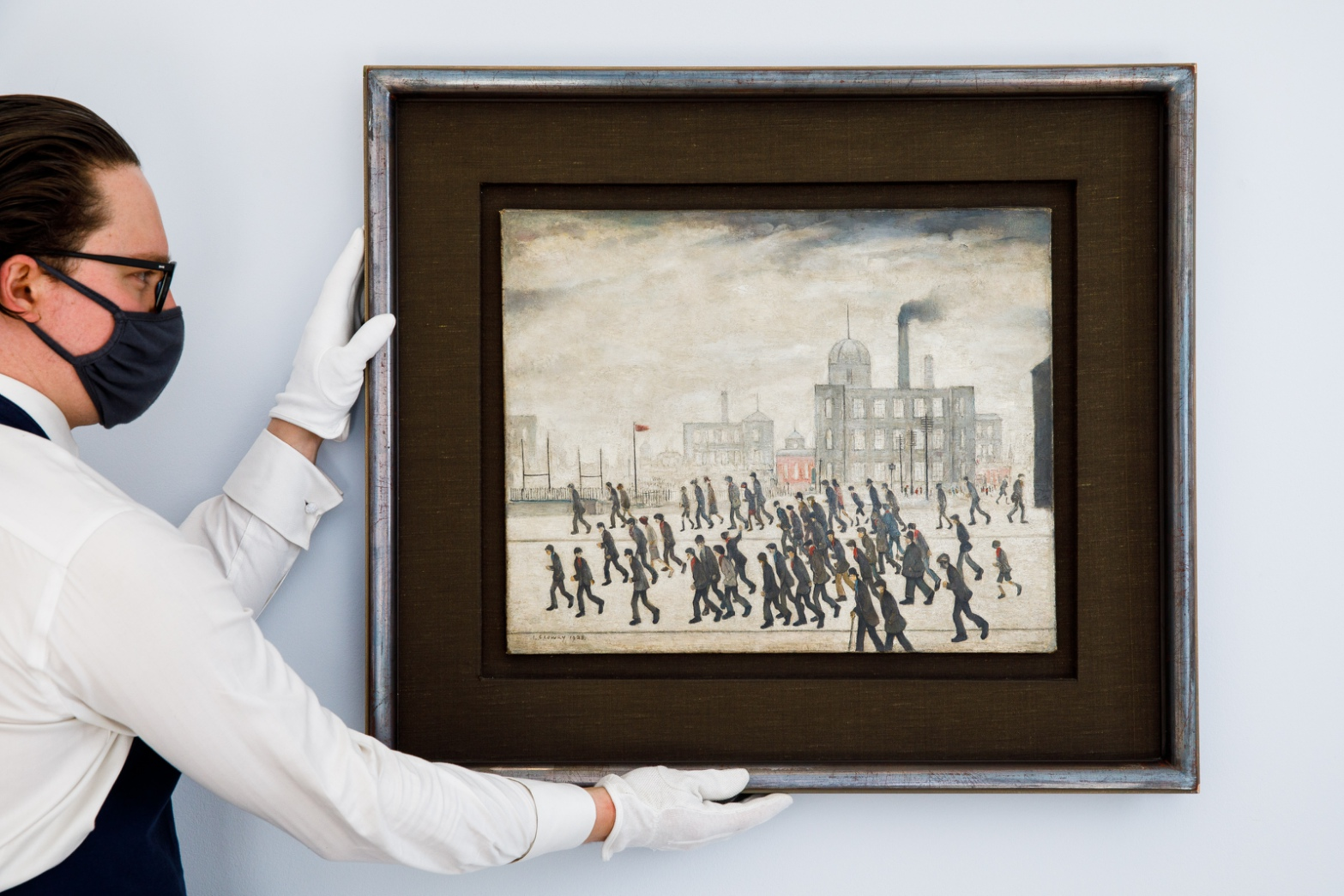 Lot 13- L_S_ Lowry, Going to the Match, 1928, oil on canvas 17 by 21in_ in situ 3.jpg