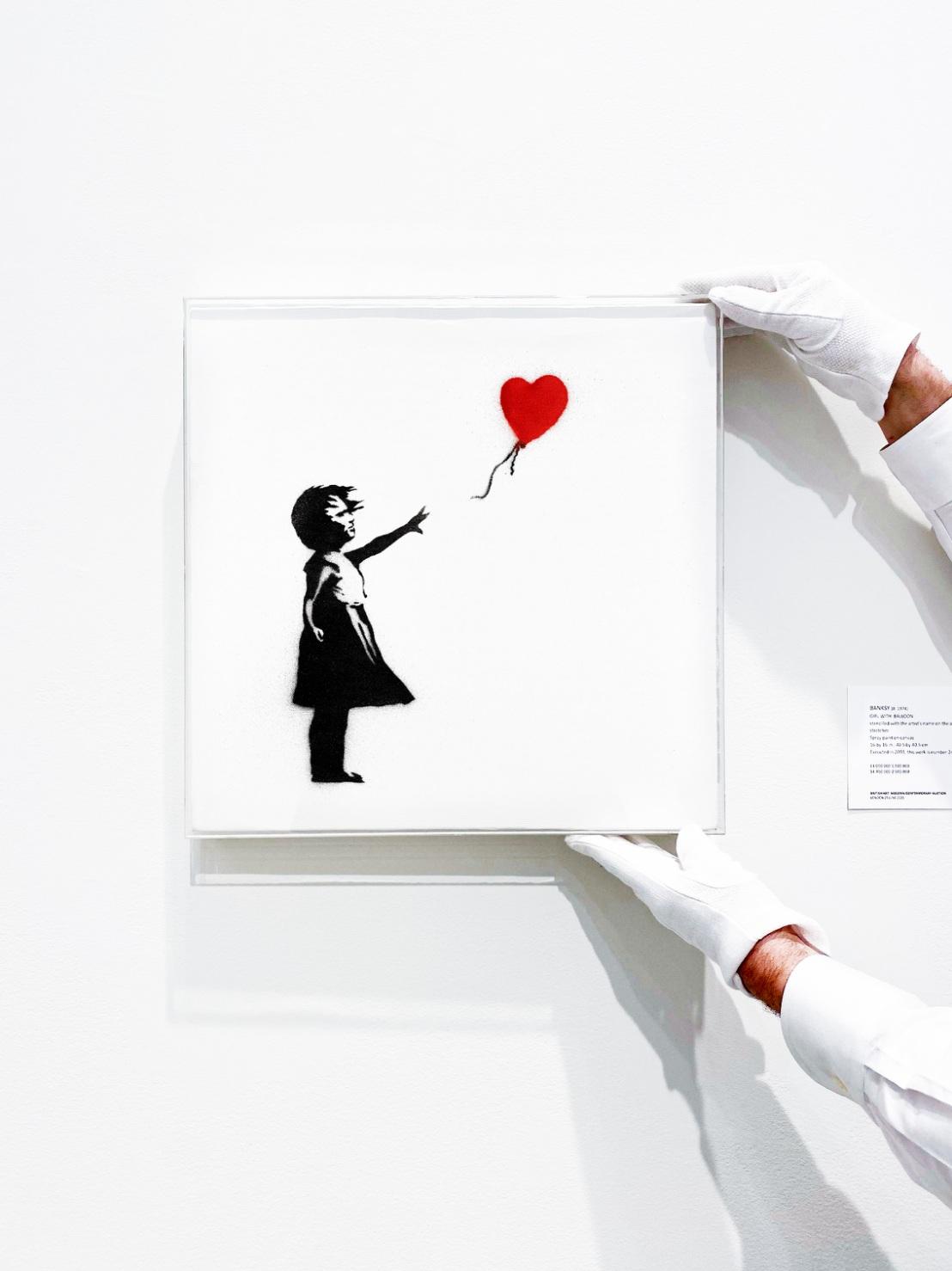 Lot 38- Banksy, Girl with Balloon, 2003,  (in situ 3).jpg