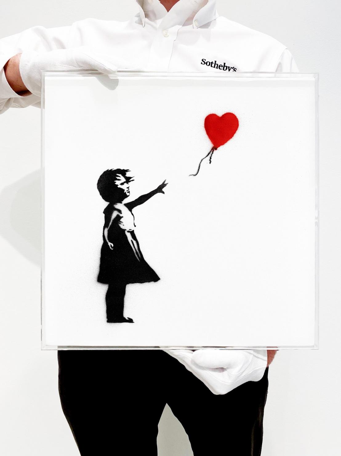 Lot 38- Banksy, Girl with Balloon, in situ 3.jpg