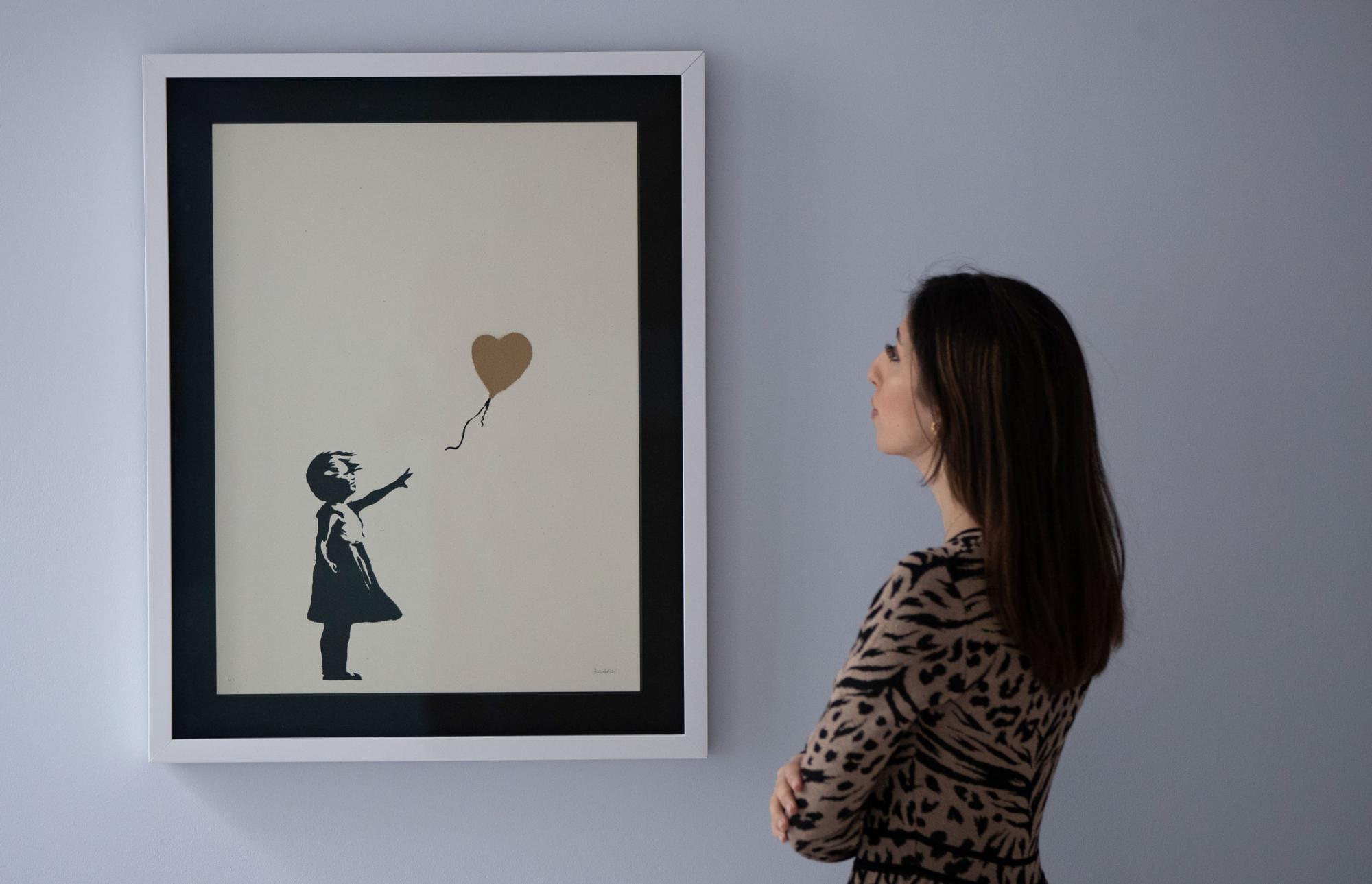 Banksy,-Girl-with-Balloon---Colour-AP-(Gold),-est.jpg